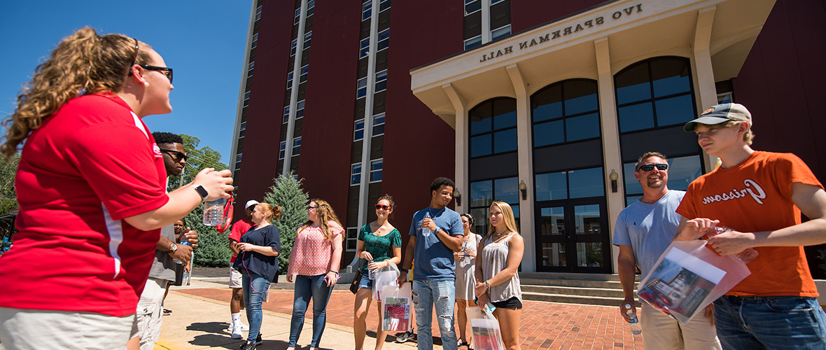 Students touring campus in front of Sparkman Hall